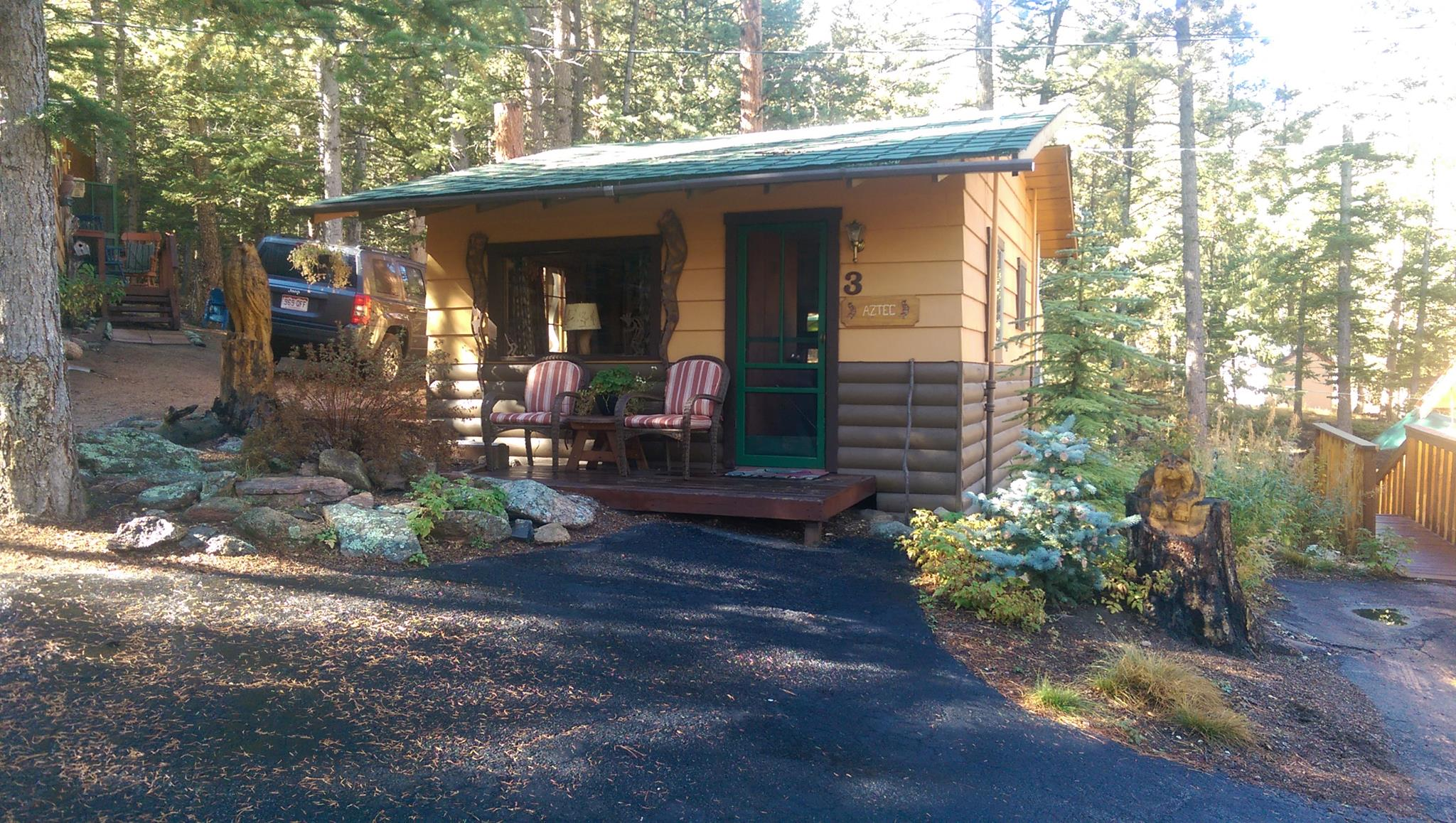 rental and cabins rocky luxury right on with mountain river both cabin rentals estes own we views park